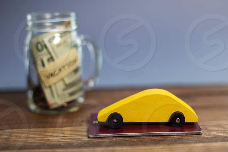 Saving money for travel in glass jar photo