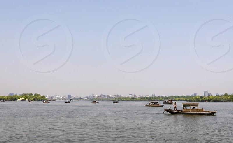 Asia china hangzhou west lake water city boats travel photo