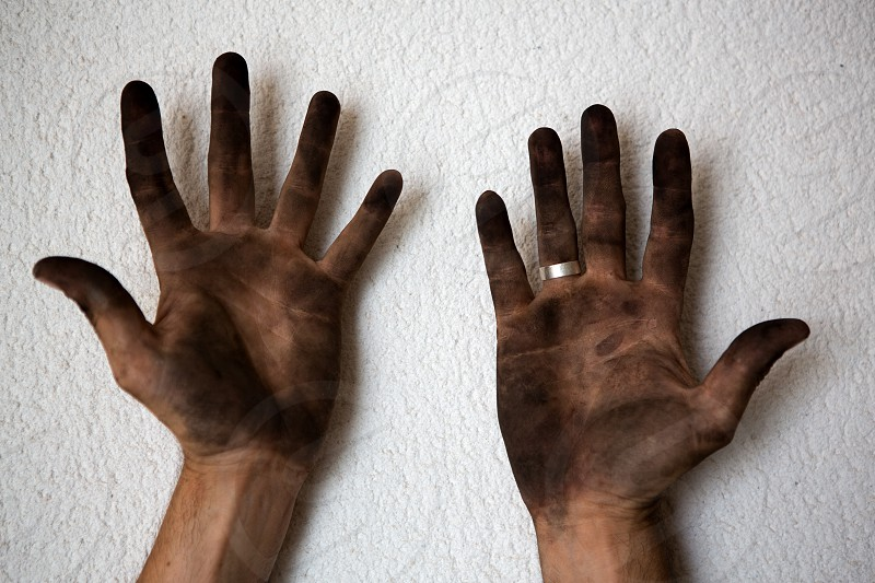 black dirty man hands open palms on white background photo