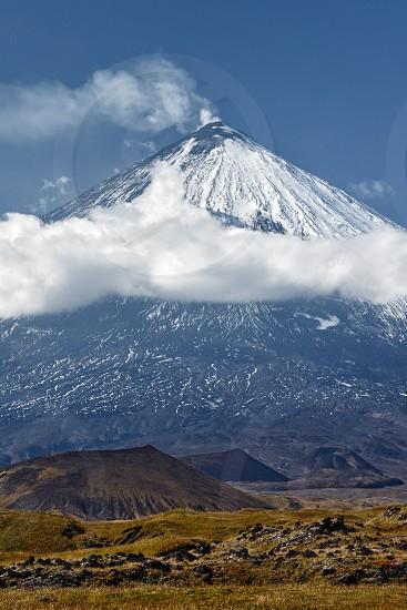 Beautiful volcanic landscape: Klyuchevskoy Volcano (Klyuchevskaya Sopka) - view of the majestic stratovolcano highest mountain on Kamchatka the highest active volcano of Eurasia. Russia Far East. photo