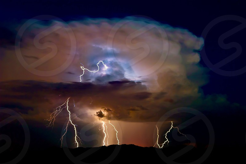 An active storm cell over the Buckeye Foot Hills in southwestern Arizona during the 2015 Monsoon season. The title of this photo is after the storm god of ancient Sumeria called Baal. photo