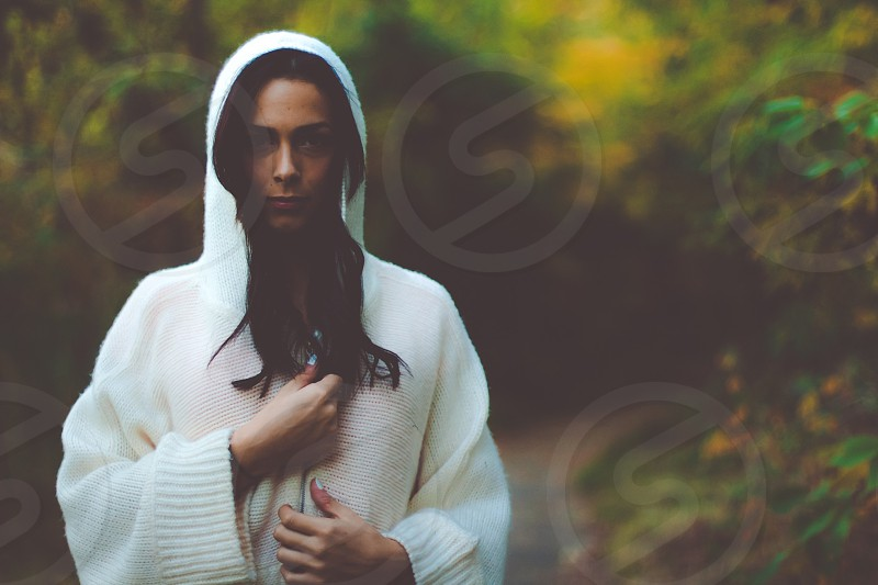 woman in white knit cardigan with hood photo