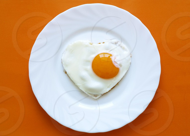 egg white plate food yellow background omelotte heart scrambled eggs photo
