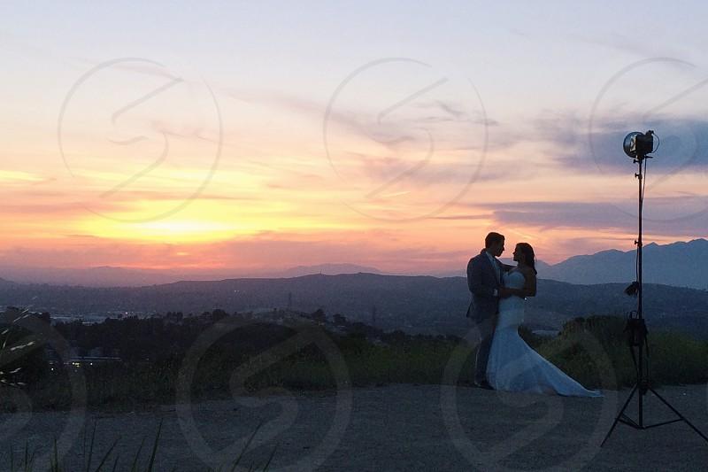 man and woman wearing wedding attire taking a photo shoot photo