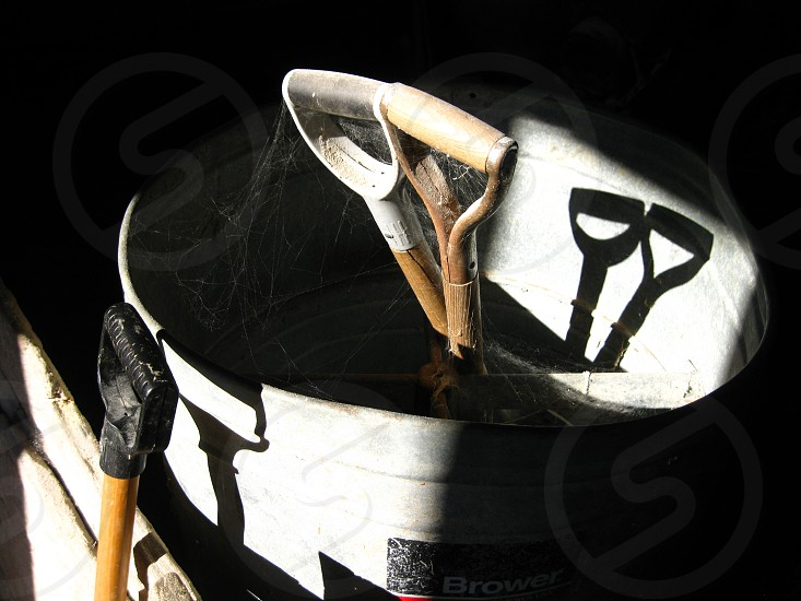 Farm shovel cobwebs dusty dirty shadow metal tools abandoned photo