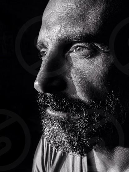 Man portrait adult wise beard guru black and white bold strong expression emotion light dark look profile future age middle life manly masculine spiritual sensei photo