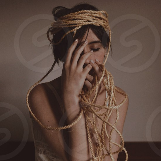 woman tied in rope photograph photo