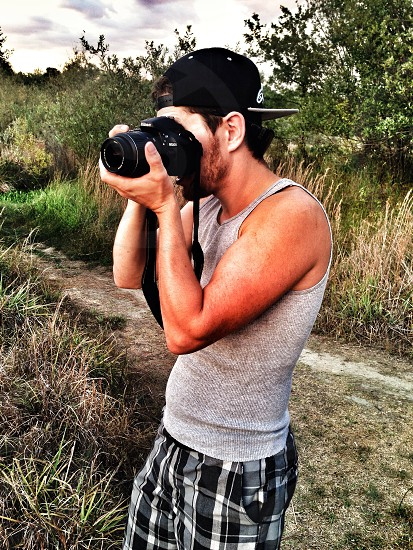 Me shooting some folks with my new Nikon my artistic outlet.  photo
