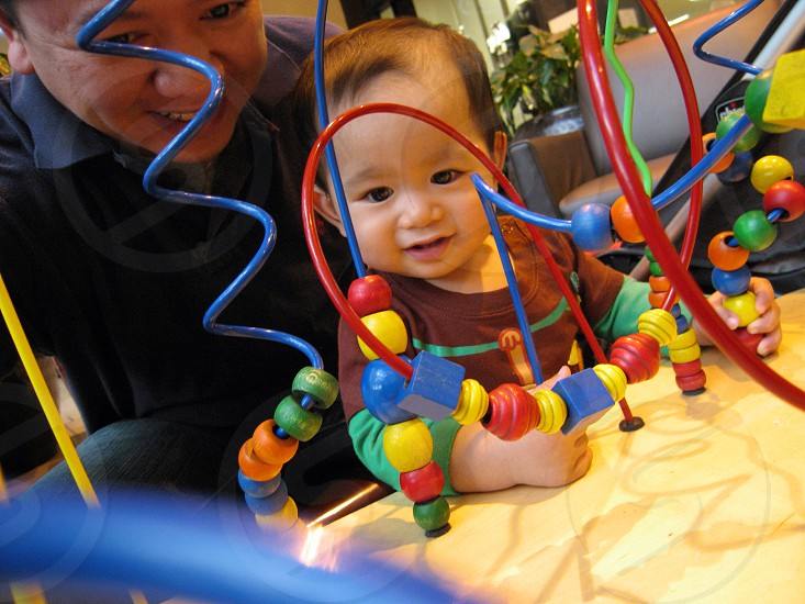 toddler playing educational toy photo