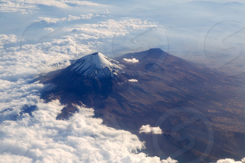Popocatepetl volcano in Mexico DF city aerial view from aircraft    photo