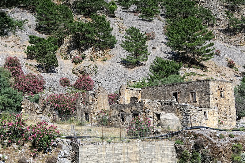 hiking through the Samaria Gorge at Crete (Greece). Old ruins of Agia Roumeli village destroying my natural water disaster. Reaching the end point of Trail. hiker resting in a tavern. photo