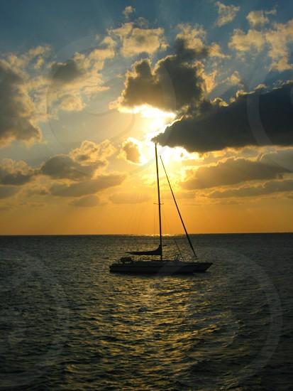 Sailing at dusk photo