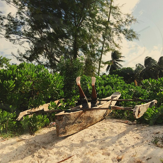 brown wooden boat on sand photo
