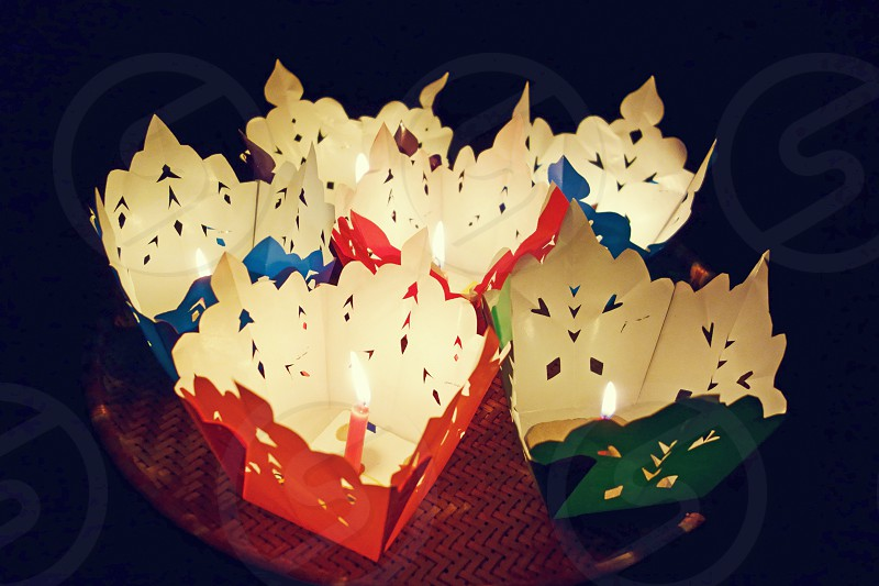 asian culture tradition wish candle floating festival background fire night urban lighting photo