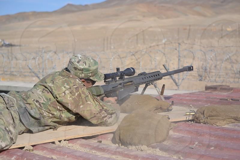 Solider shooting .50 Caliber Sniper Rifle photo