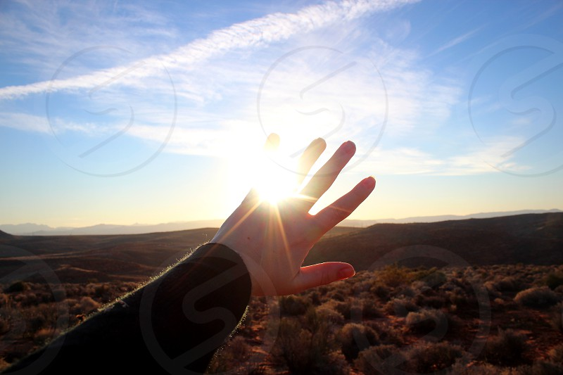 light reaching for the light mountains sunrise hope happy try open skies potential photo