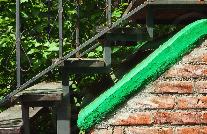 One detail of an old metal staircases.  photo