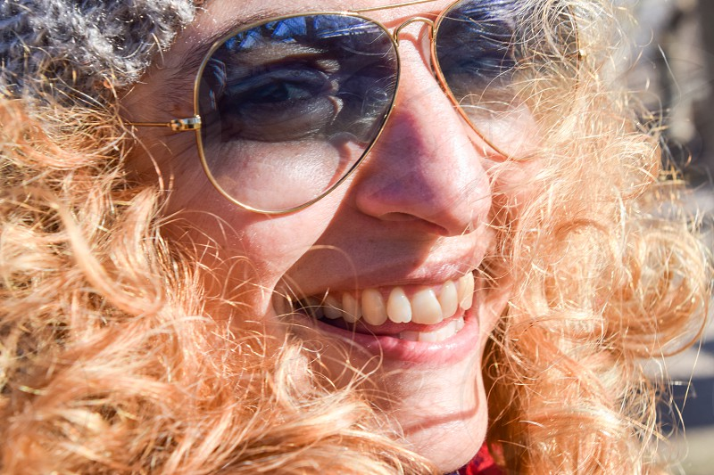 Beautiful Happy Smiling Woman Wearing Sunglasses photo