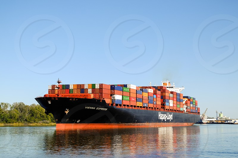 Huge container ship Hapag-Lloyd near the port in Savannah GA USA photo