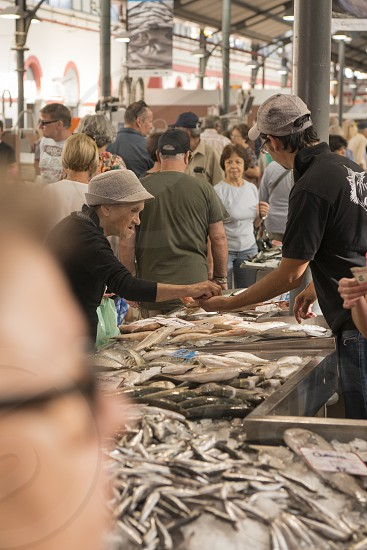 the fishmarket in the Markethall in the town of Loule in the Algarve in the south of Portugal in Europe. photo
