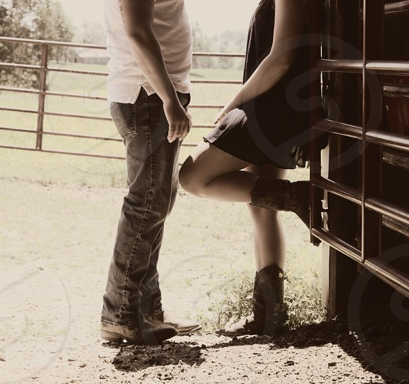 country couple romance cowboy cowgirl boots photo