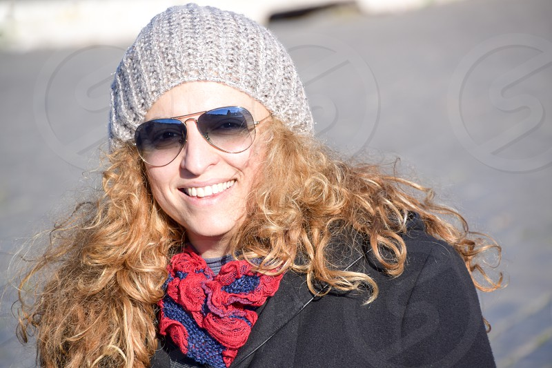 Beautiful Happy Smiling Blonde Woman In The Street photo
