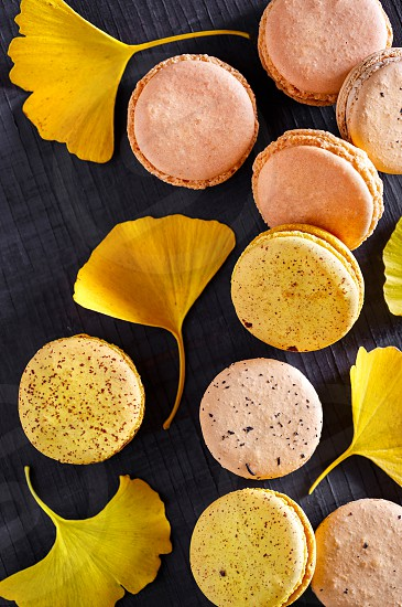 Autumn French macarons with gingko leaves photo