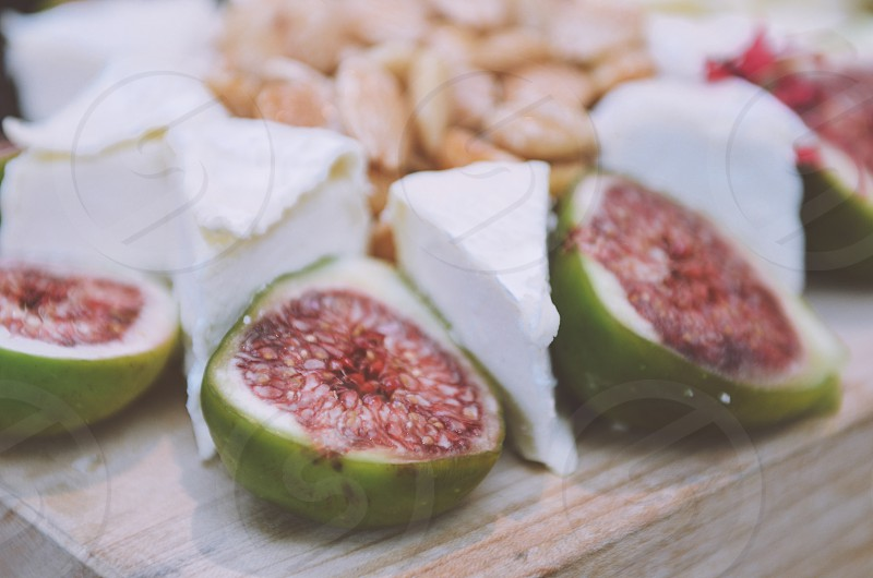 Figs Brie salted almonds cheese board display catering food photo