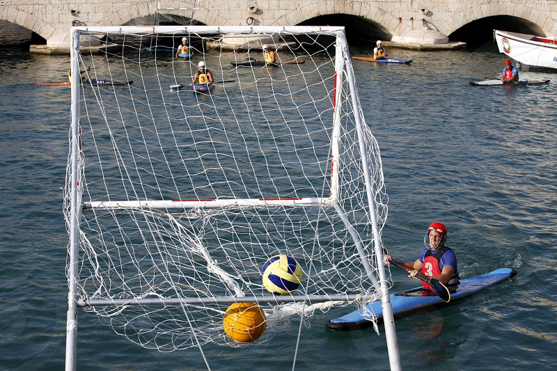a Water Kanu Ball Game in the Harbour in the old town of Siracusa in Sicily in south Italy in Europe. photo
