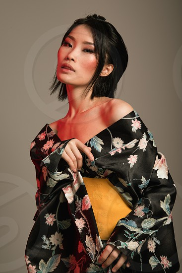 chinese beauty dressed in Japanese kimono. Asia is all about red lights photo