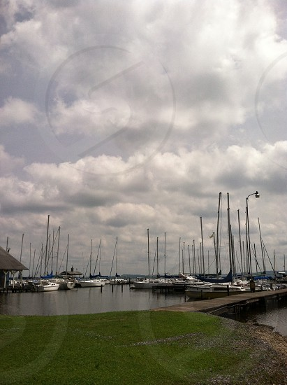 white sailing boat on parking on a pier  photo