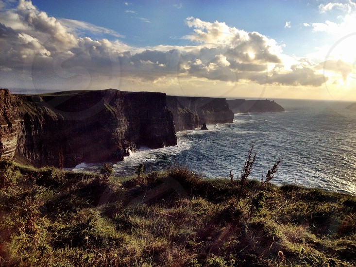 The amazing Cliffs of Moher Ireland at sunset in October  photo