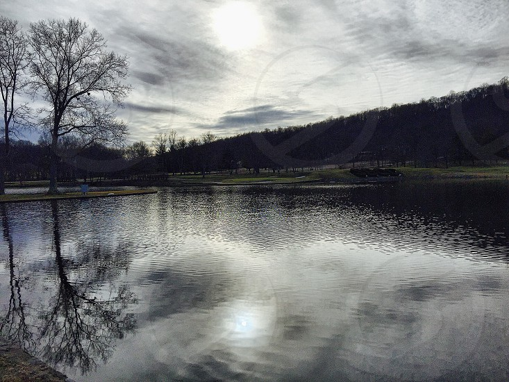 body of water near mountain photo photo