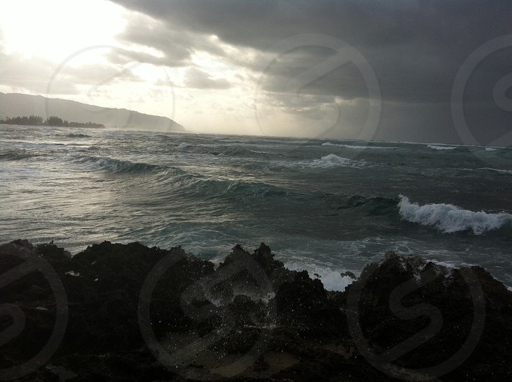 Grey Clouds Over Ocean Waves photo