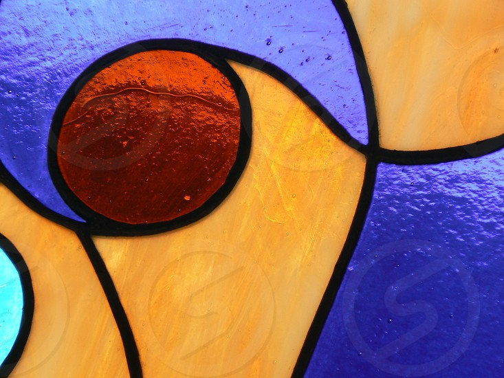 Stained glass. Blue yellow red. photo