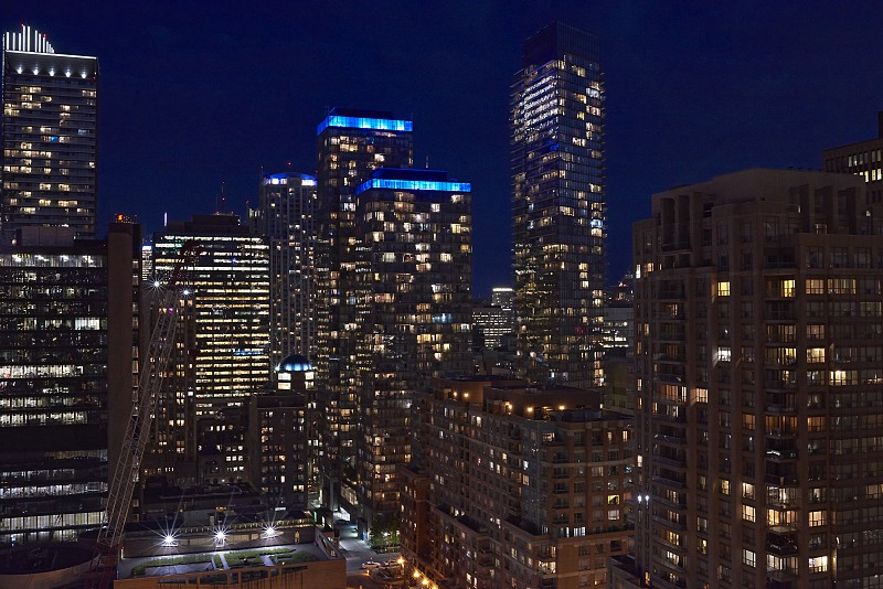 View of the business district and its skyscrapers is in Toronto city at night photo