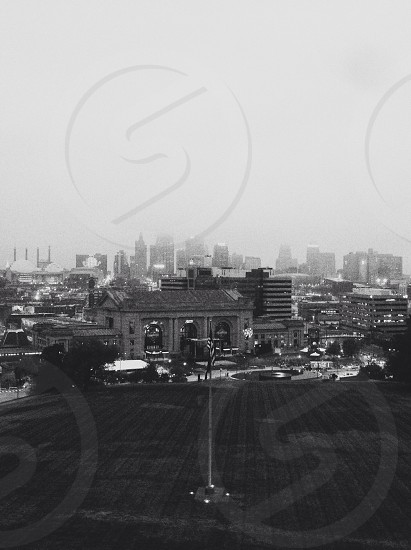 grayscale photo of high buildings photo