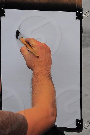 artist using a pencil smudging technique photo