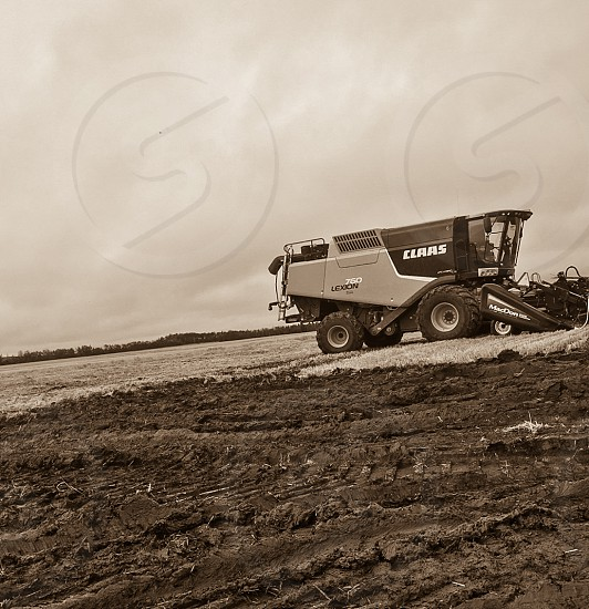 Lexion Combine harvesting mud fall rough job photo