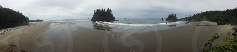 panoramic view of small inlet with large rocky outcroppings photo