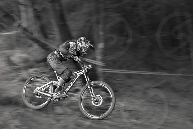 Action sport race bike biker cyclist bicycle blackandwhite speed b&w racing mountainbike speeding blur fast  photo