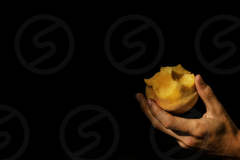juicy bitten peach caught by hand on black background by juan ramon ramos rivero photo stock snapwire snapwire
