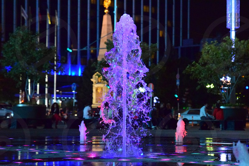 dancing fountain with purple and red LED lights photo