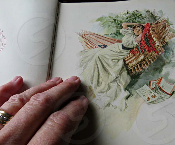 Looking at an antique book. photo