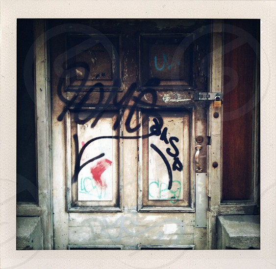 A doorway with graffiti photo