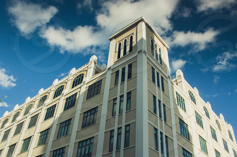 white and beige painted tall building photo