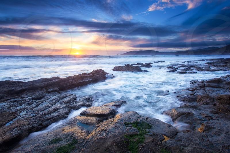 A beautiful coastal scene at sunset in Shell Beach California. photo