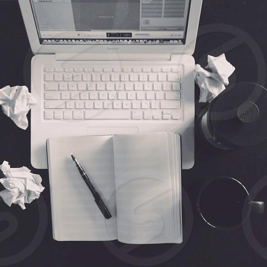 white laptop on table photo