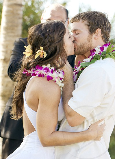 Hawaii wedding couple having their first kiss.  photo