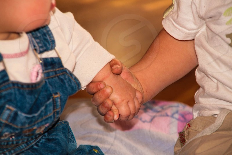 Siblings brother sister happy hands holding children kids proud photo